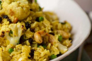 Indian spiced biryani with cauliflower, currants and peas