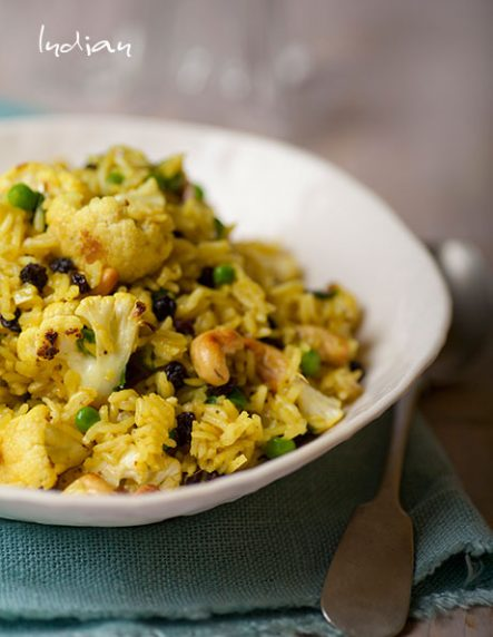 Indian Biryani with cauliflower, currants and peas